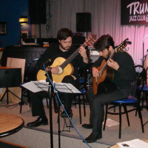 2 Young Men Playing Guitar On Stage At Trumpets Jazz Club And Restaurant